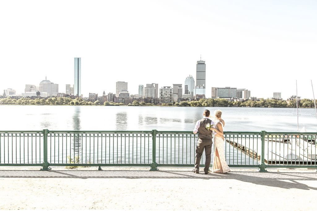 A bride and groom eloped in Boston this is their first time seeing the Charles river